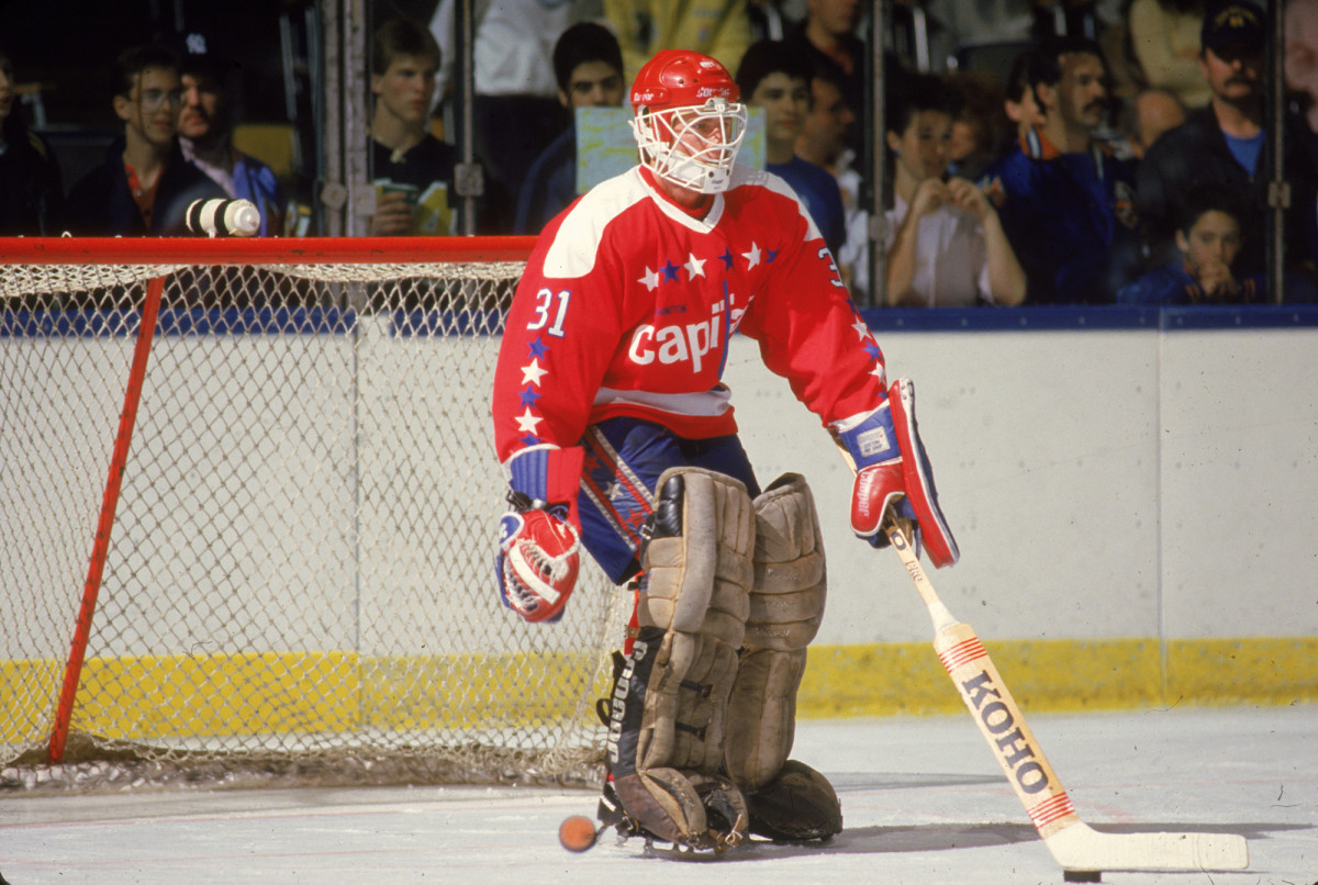 Washington Capitals goalie Bob Mason tends the goal during warm-up before a road game against the New York Islanders in the 1980s.