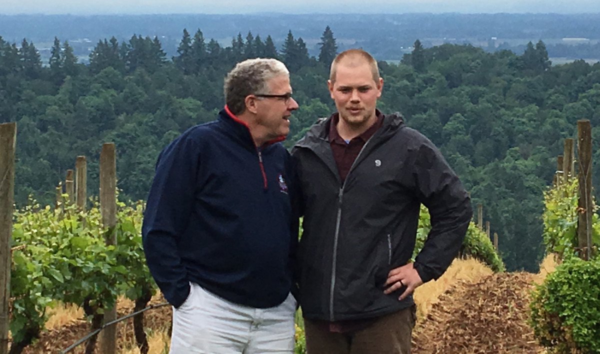 Jackson Holstein (right) with Peter King at the Granville Wines vineyard in Dundee, Ore.