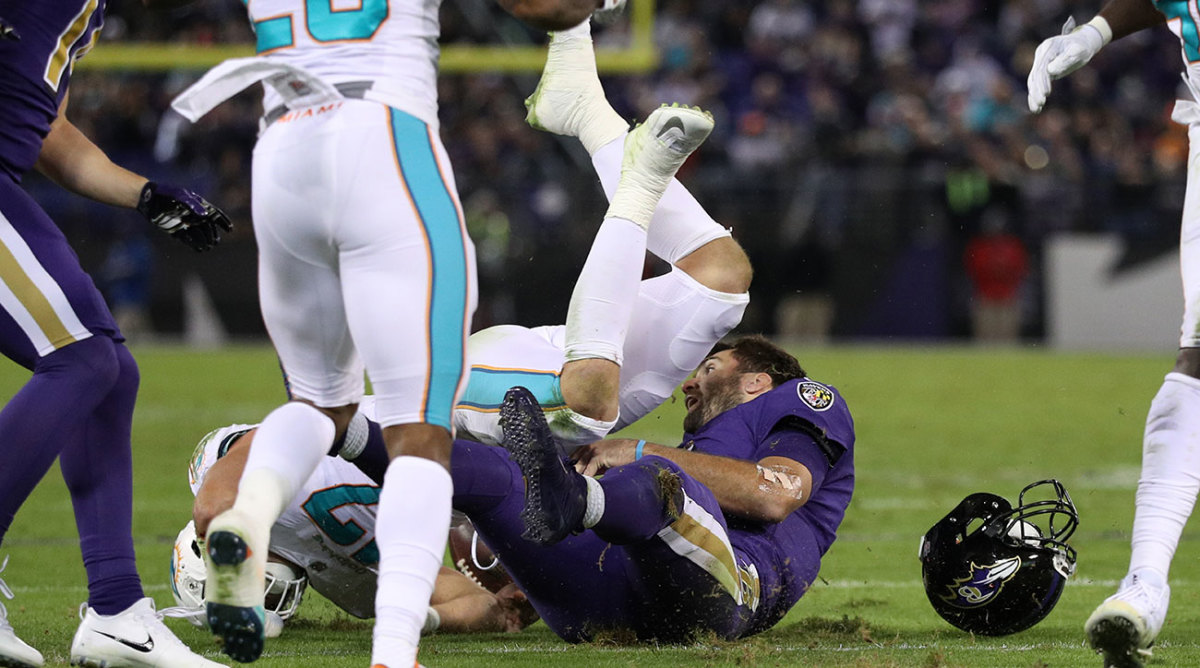 Joe Flacco left Thursday's game after being hit by Kiko Alonso.