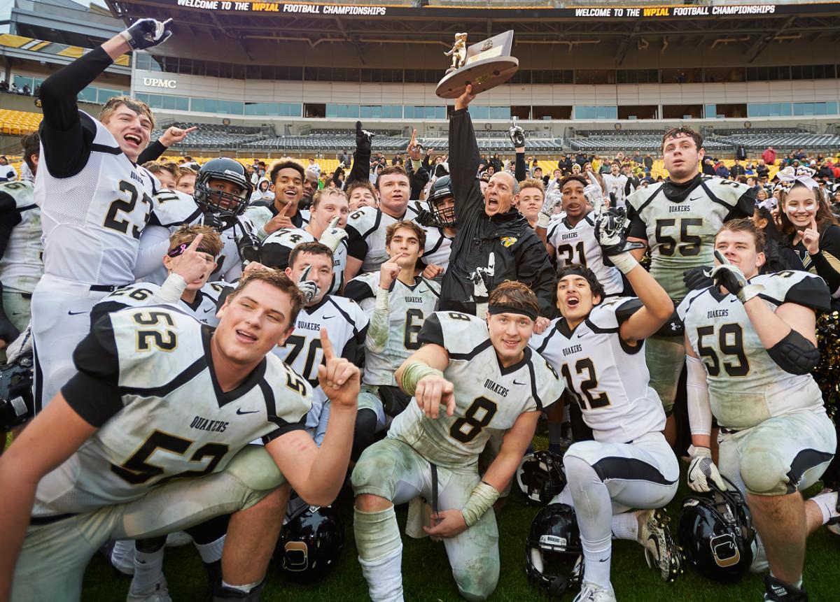 Quaker Valley hoist the trophy.