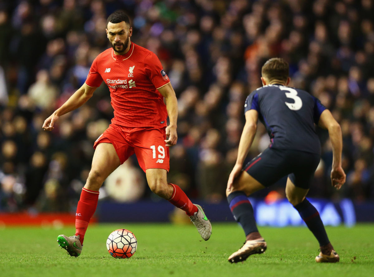 LIVERPOOL, ENGLAND - JANUARY 30:  Steven Caulker of Liverpool is watched by Aaron Cresswell of West Ham United during the Emirates FA Cup Fourth Round match between Liverpool and West Ham United at Anfield on January 30, 2016 in Liverpool, England.  (Photo by Clive Brunskill/Getty Images)