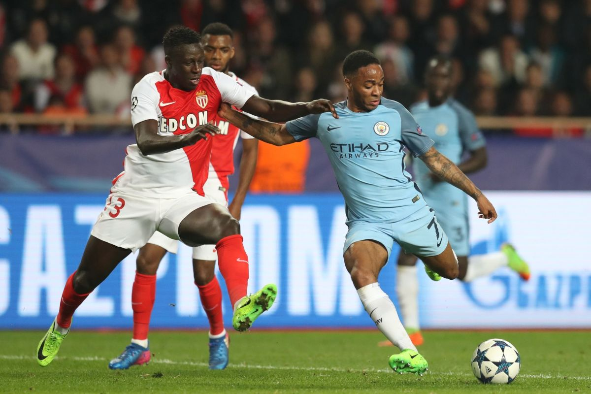 Monaco's French defender Benjamin Mendy (L) challenges Manchester City's English midfielder Raheem Sterling during the UEFA Champions League round of 16 football match between Monaco and Manchester City at the Stade Louis II in Monaco on March 15, 2017. / AFP PHOTO / Valery HACHE        (Photo credit should read VALERY HACHE/AFP/Getty Images)