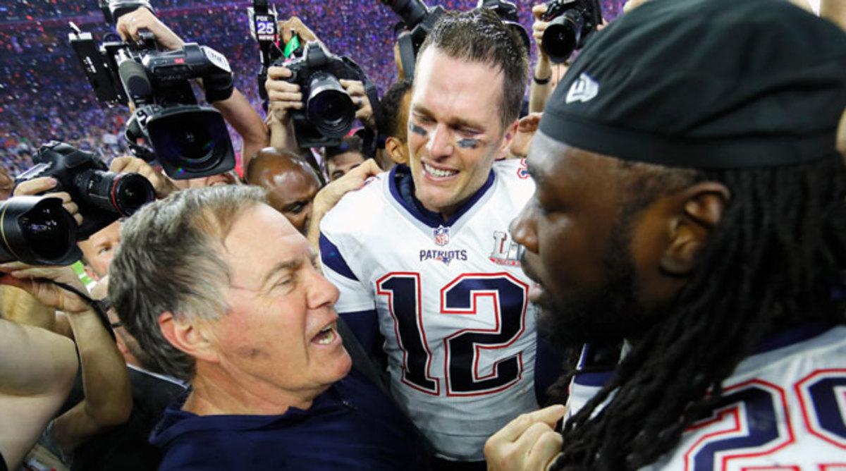 Tom Brady and Bill Belichick celebrate after Super Bowl 51.
