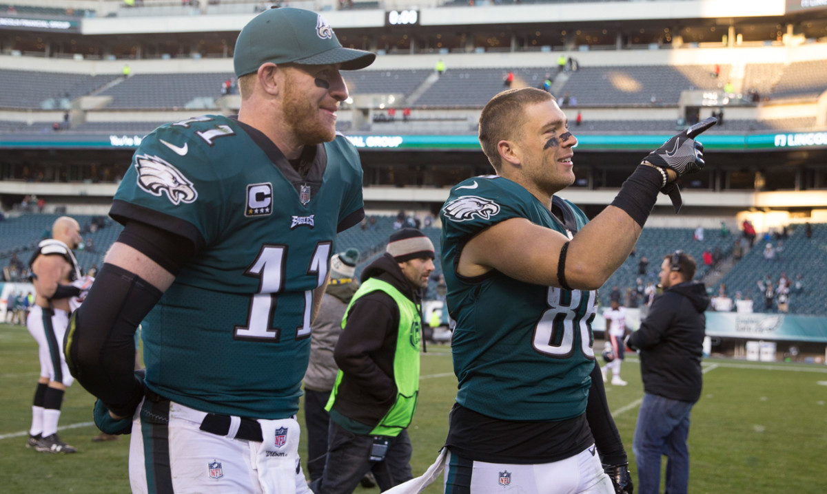 Wentz and Zach walk off after the win.