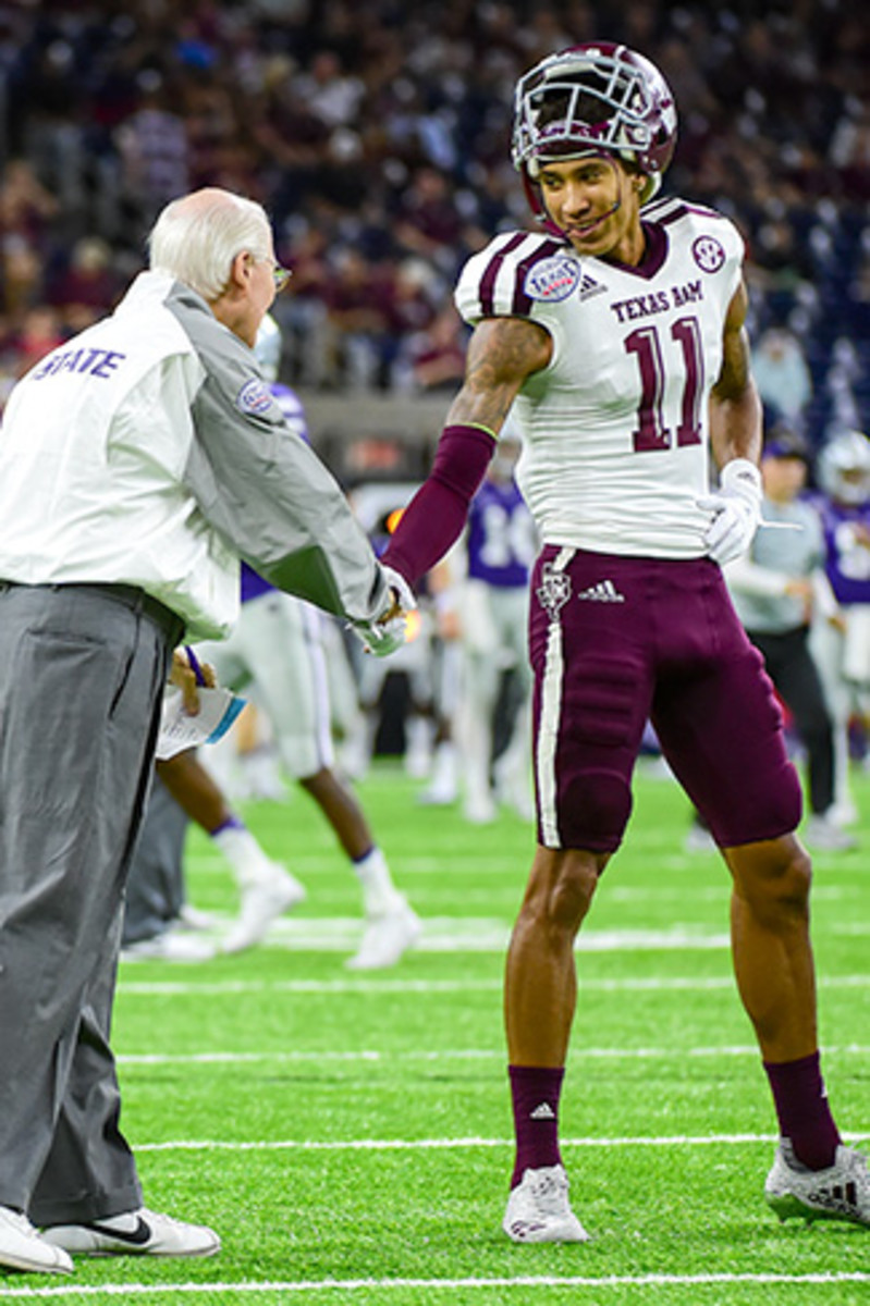 Reynolds is greeted by Bill Snyder before his final collegiate game in the Texas Bowl.