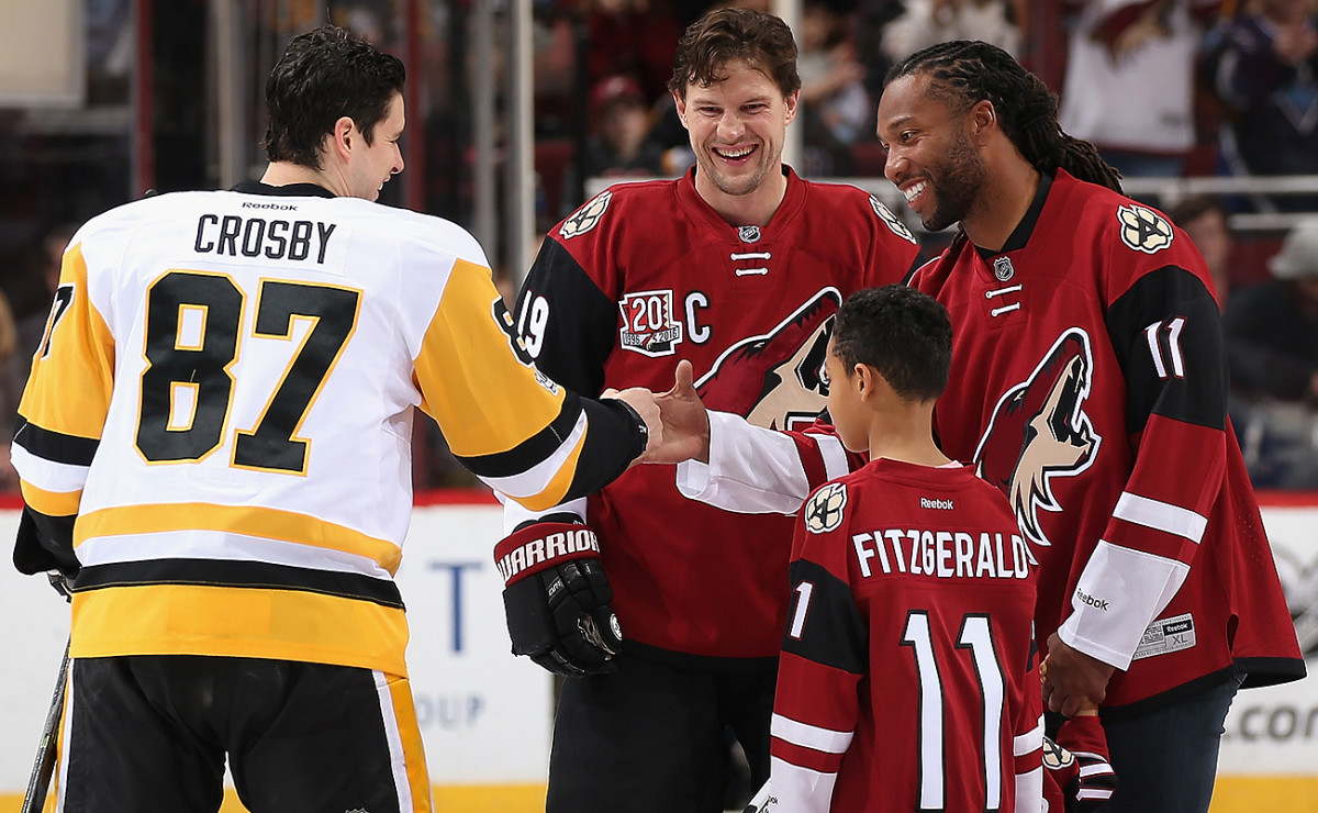 Larry Fitzgerald greeted Sidney Crosby and Shane Dolan before dropping the puck Saturday night.