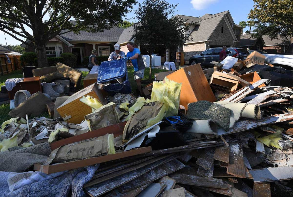 Garbage piles became ubiquitous as people discarded ruined furniture, flooring and possessions.