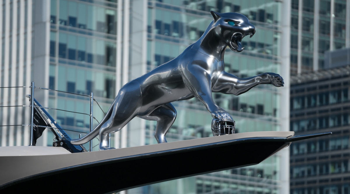 A gleaming jaguar graces the prow of Khan's $200 million ship.