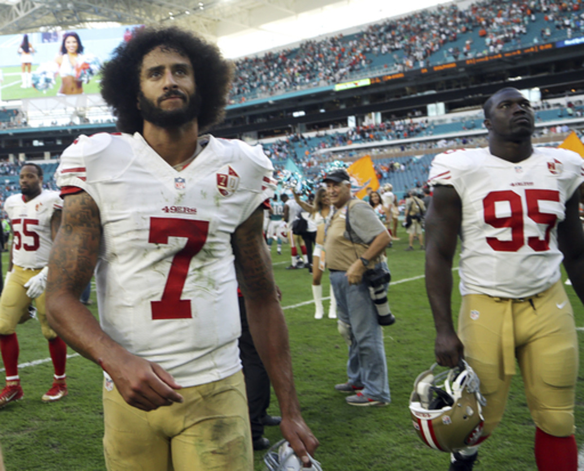 San Francisco 49ers quarterback Colin Kaepernick (7) and San Francisco 49ers linebacker Tank Carradine (95), leave the field at the end of an NFL football game against the Miami Dolphins, Sunday, Nov. 27, 2016, in Miami Gardens, Fla. The Dolphins defeated