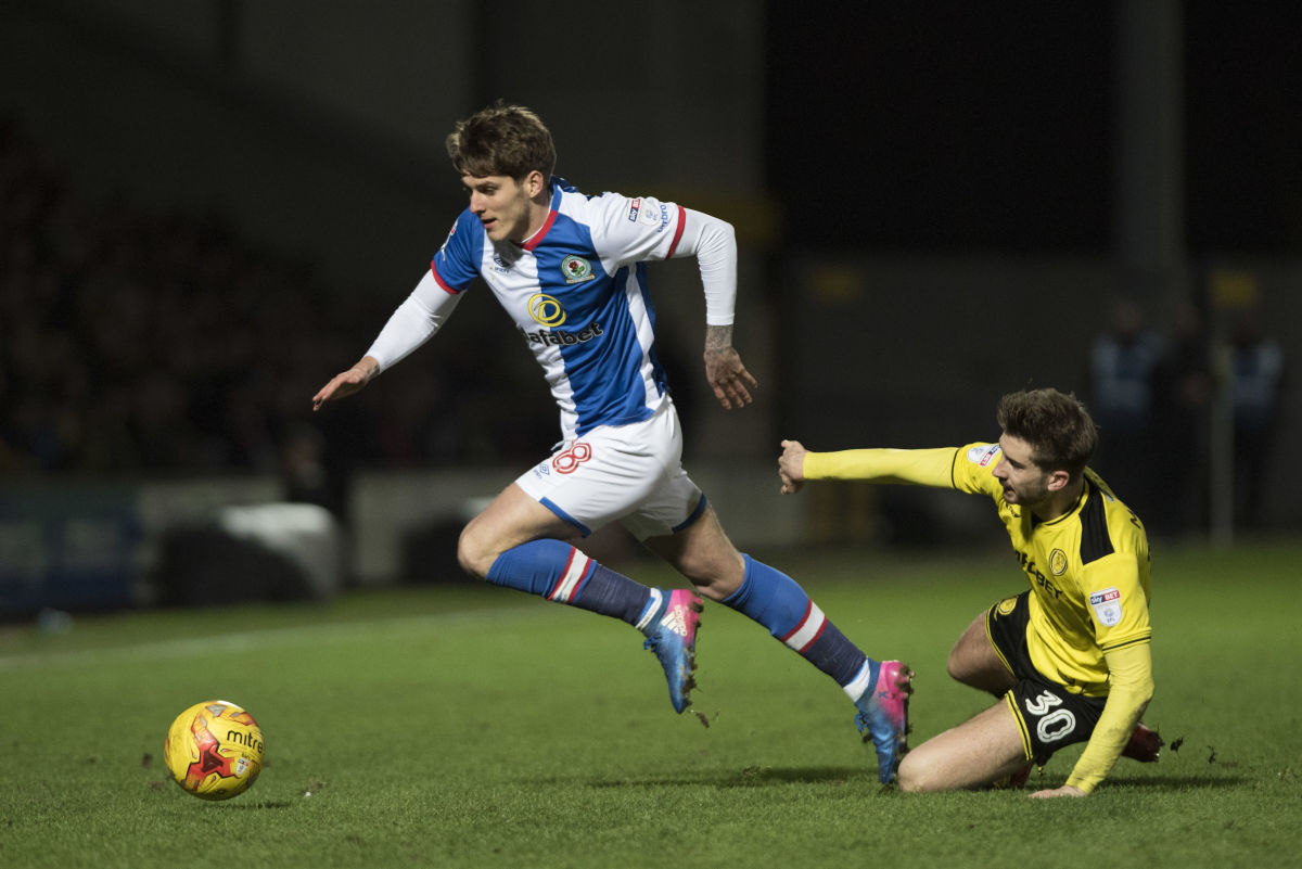 BURTON-UPON-TRENT, ENGLAND-FEBRUARY 24: Connor Mahoney of Blackburn Rovers and Luke Murphy of Burton Albion in action during the Sky Bet Championship match between Burton Albion and Blackburn Rovers at Pirelli Stadium on February 24, 2017 in Burton-upon-Trent, England (Photo by Nathan Stirk/Getty Images).