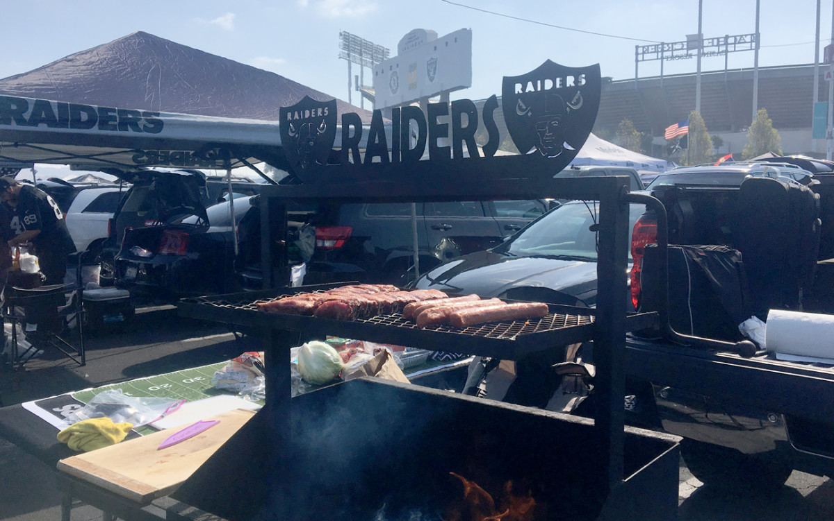 Serious grill, and grilling, outside Oakland-Alameda County Stadium.