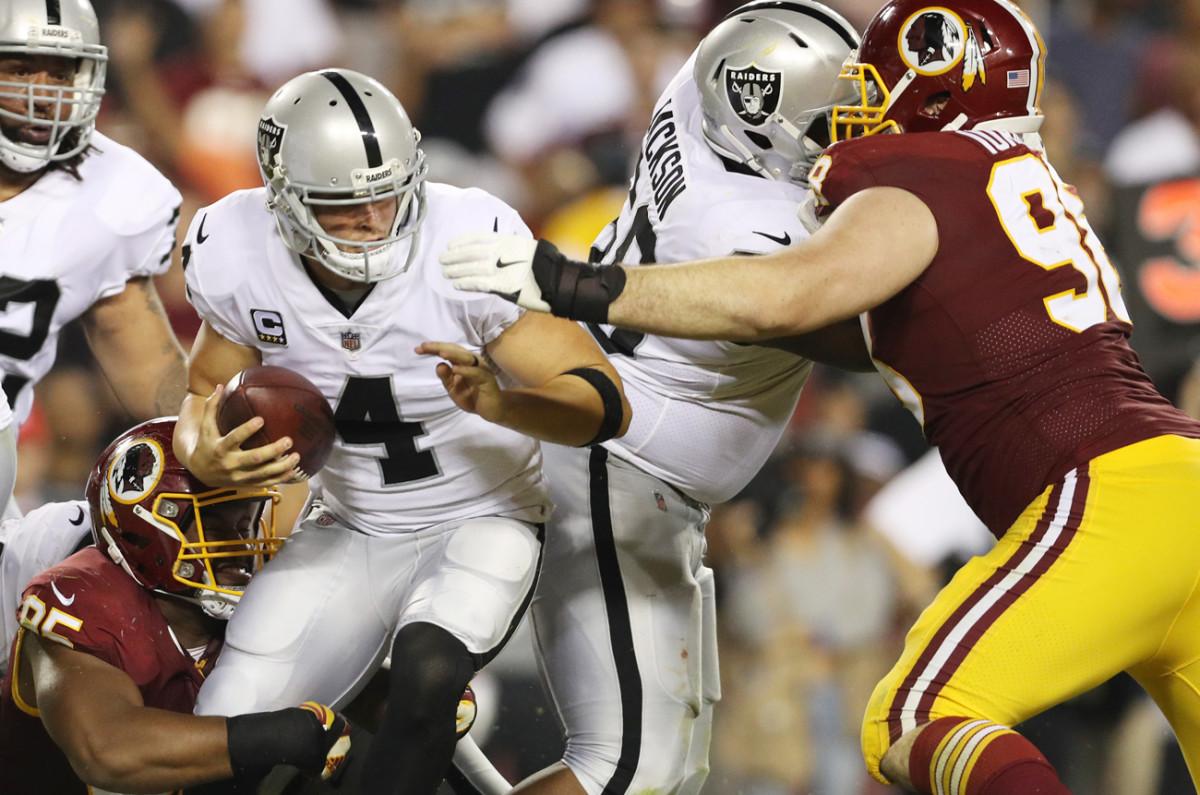 Raiders quarterback Derek Carr had nowhere to go against the Washington defense on Sunday night.