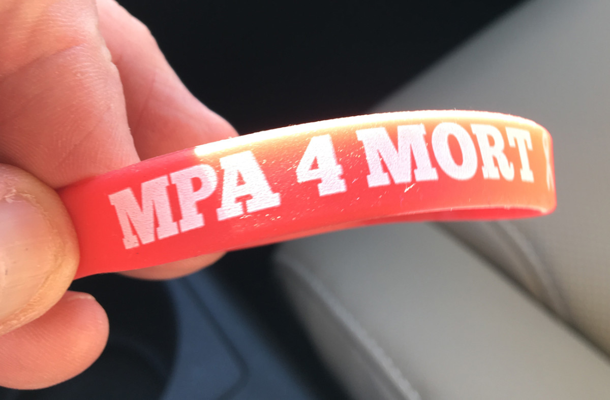 Mortensen was a fixture at the Manning Passing Academy. When he couldn't make it in 2016, Archie had supportive wristbands distributed to all the campers.