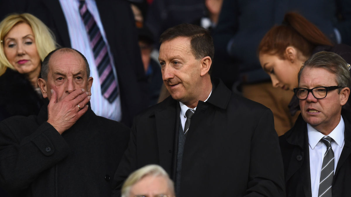 SWANSEA, WALES - DECEMBER 20:  Swansea chairman Huw Jenkins (c) looks on before during the Barclays Premier League match between Swansea City and West Ham United at the Liberty Stadium on December 20, 2015 in Swansea, Wales.  (Photo by Stu Forster/Getty Images)