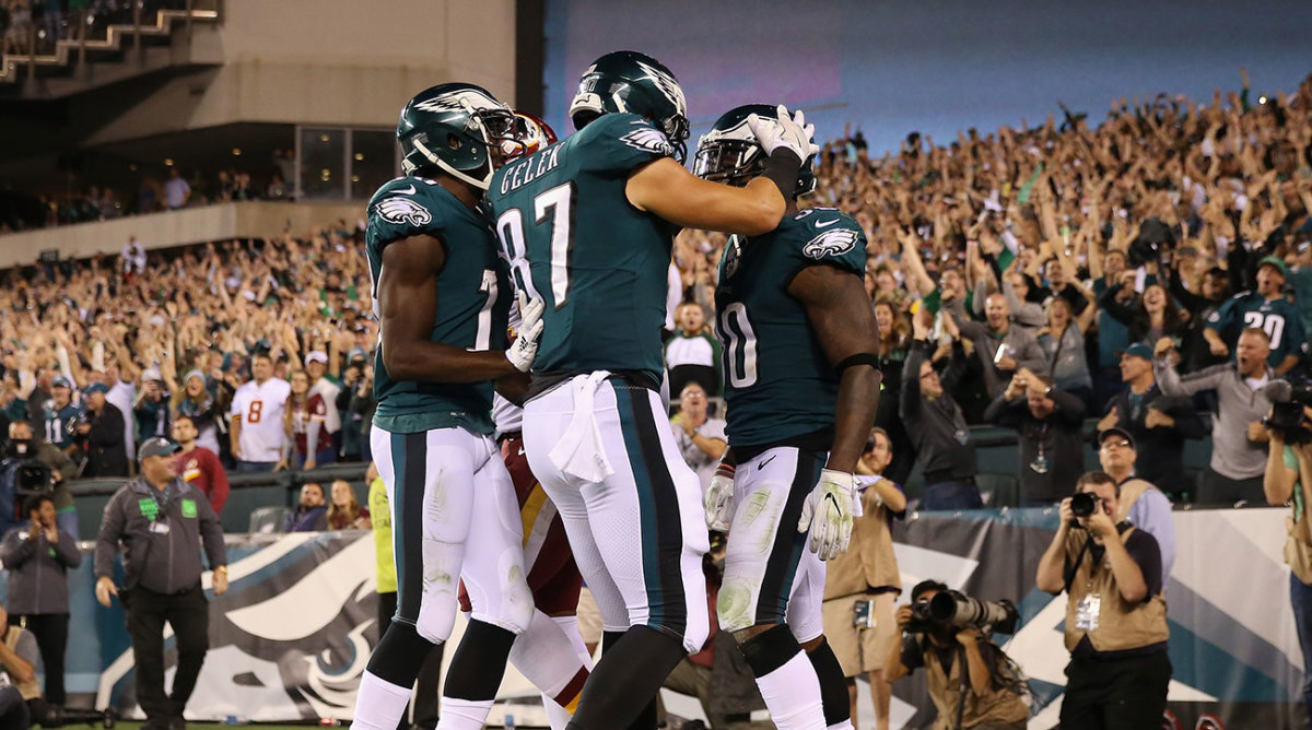 The Eagles celebrate a touchdown during a win Monday night.