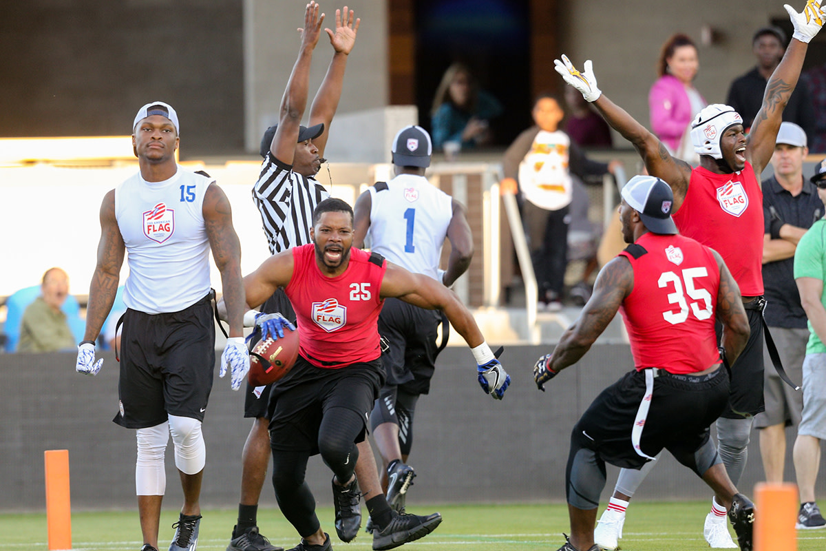 The NFL influences on the AFFL's pilot game were evident as Kerry Rhodes (25) and former Patriots RB Jonas Gray (35) celebrated a touchdown.