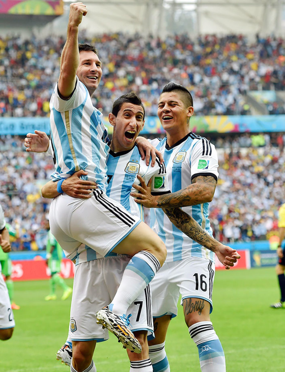 2014-0625-Lionel-Messi-Angel-di-Maria-Marcos-Rojo.jpg
