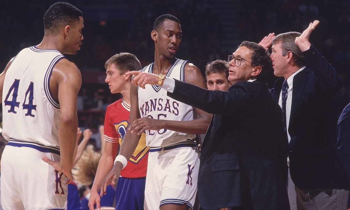 A young Gregg Popovich (far right) dishes advice to Kansas star Danny Manning.