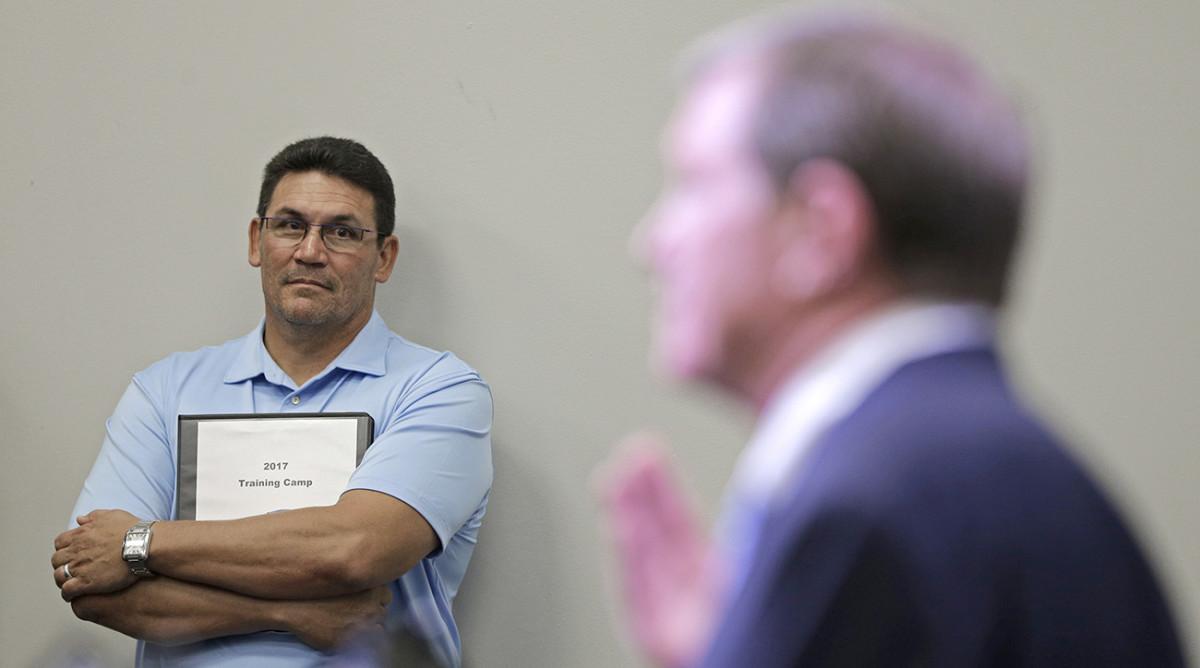 Rivera listened to Hurney address the press on Wednesday.