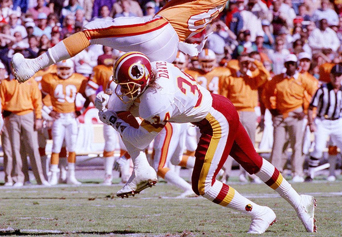 Redskins CB Brian Davis upends Buccaneers WR Mark Carrier.