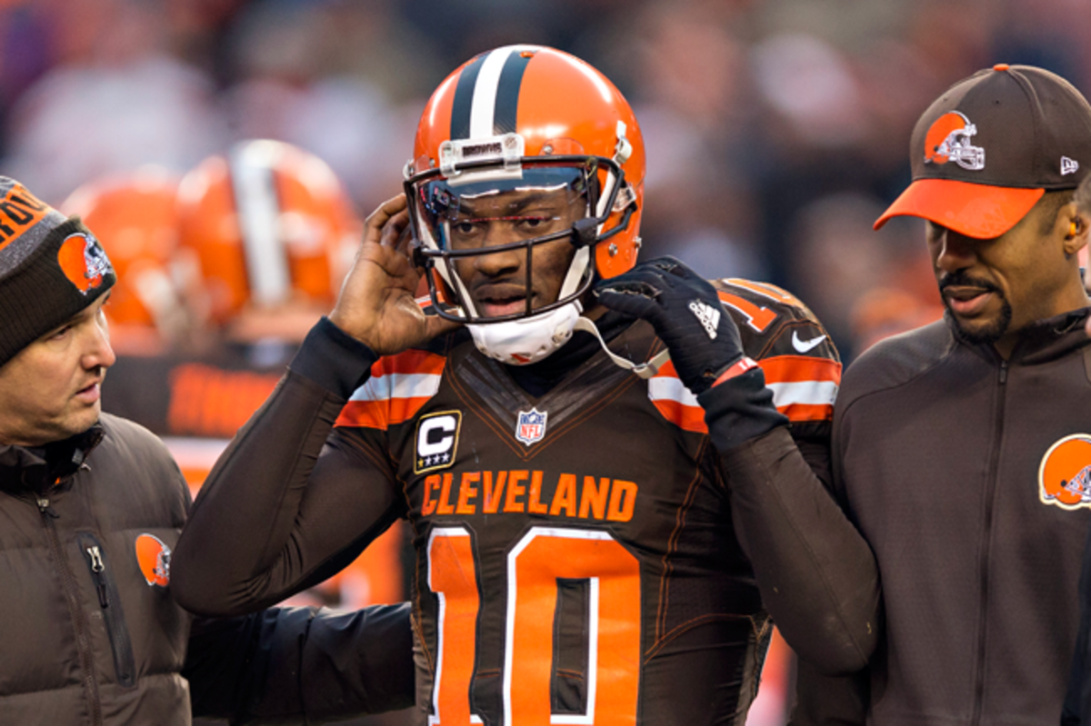 Robert Griffin III is helped off the field after suffering a concussion last December.