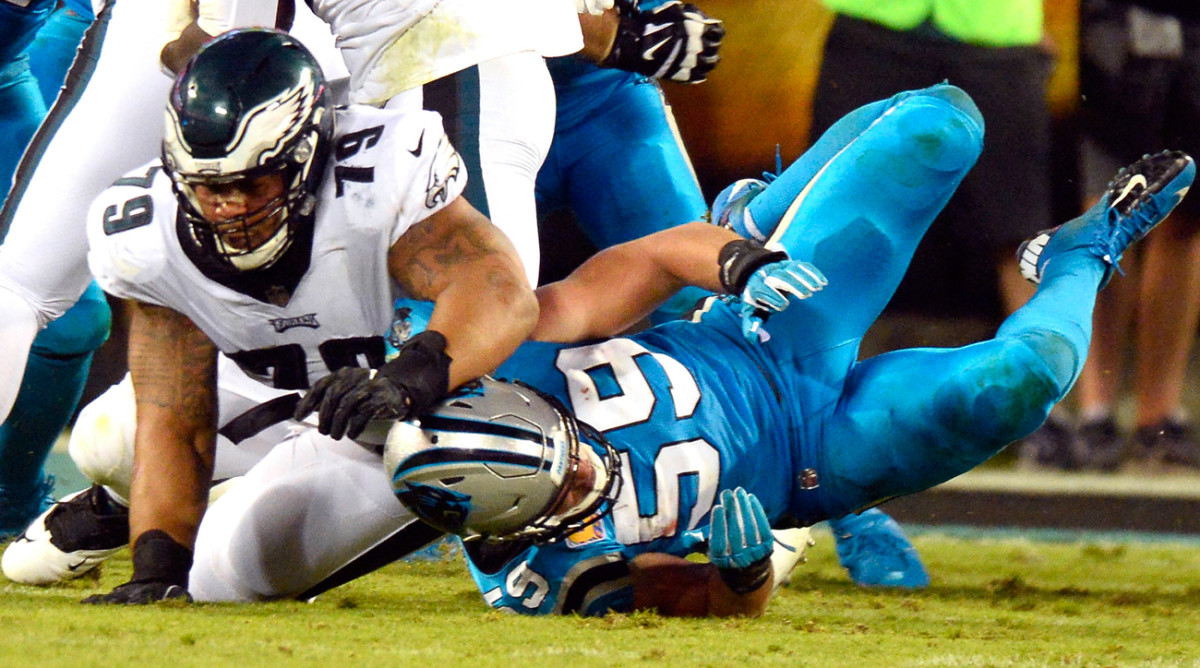 The aftermath of the collision between Brandon Brooks and Luke Kuechly that forced the latter from the game.
