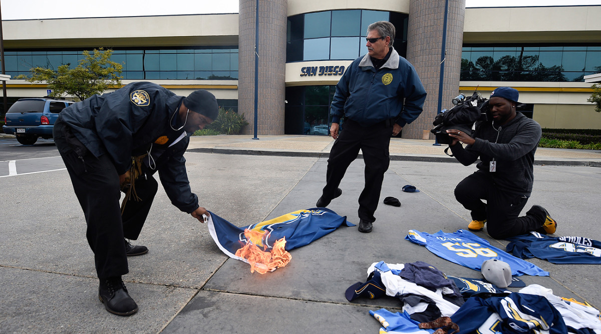 San Diego Chargers fans set fire to team merchandise after the franchise moved to Los Angeles.