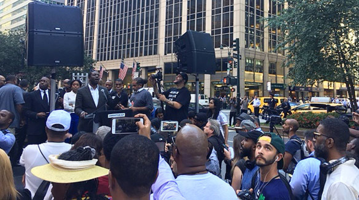 Stephen Green, the president of The People's Consortium for Human and Civil Rights, delivers his speech in front of the NFL offices.
