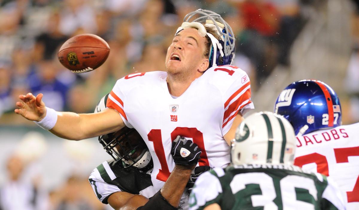 Calvin Pace's preseason shot dislodged Eli's helmet.
