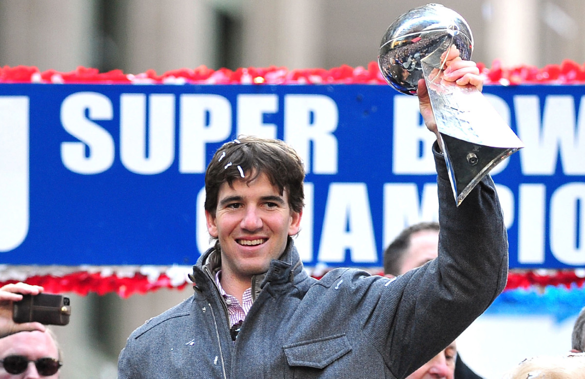 New York's favorite Manning face: The city's most unassuming superstar brandishes the Lombardi Trophy.