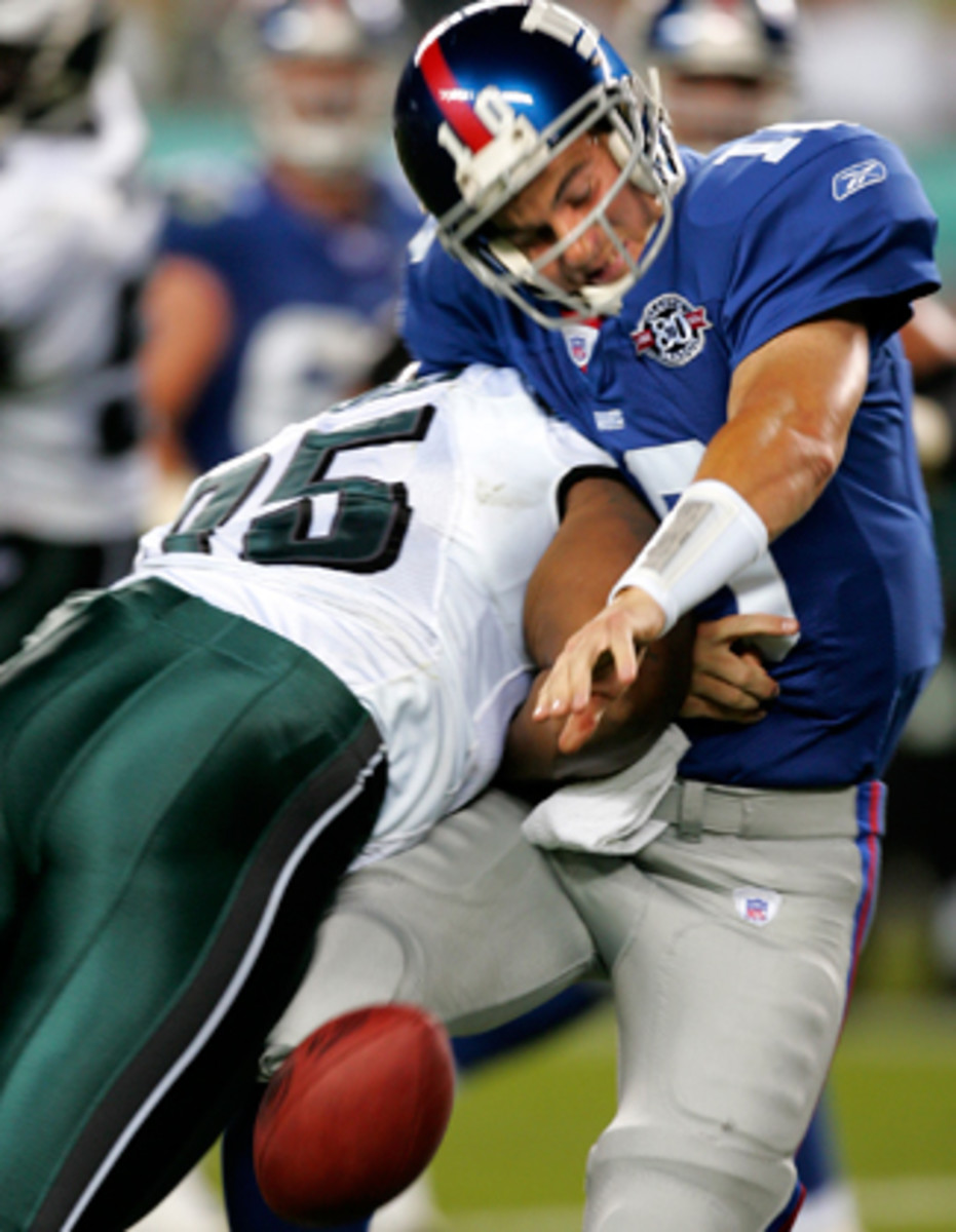 First NFL game, first NFL hit: Jerome McDougle lays out Eli in September 2004.