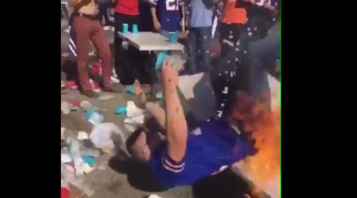 bills-fan-on-fire-burning-table.jpg