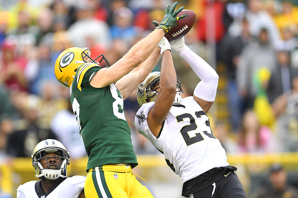 Marshon Lattimore breaks up a pass intended for Packers WR Jordy Nelson.