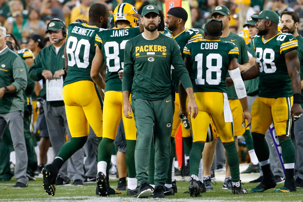 Aaron Rodgers dressed in uniform and participated in pre-game warmups but was on the sideline in street clothes for the Packers-Eagles preseason game last Thursday.