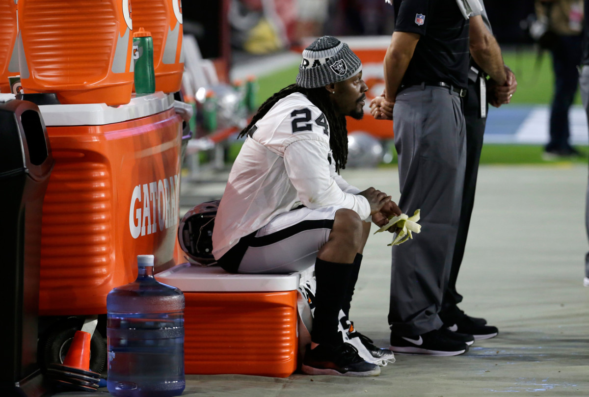 Raiders running back Marshawn Lynch sat and ate a banana during the national anthem before the Oakland-Arizona preseason game on Saturday.