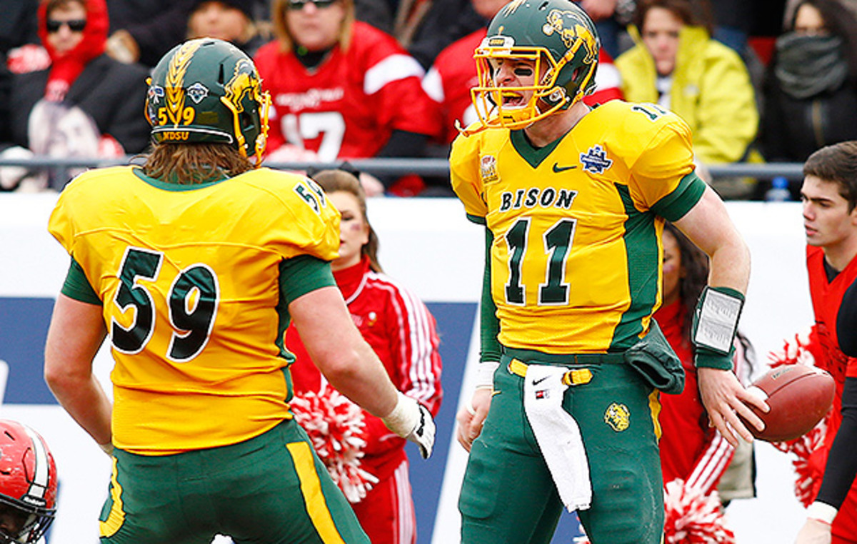 Haeg (59) started on four national championship teams at NDSU, the final two of which had Carson Wentz (right) under center.