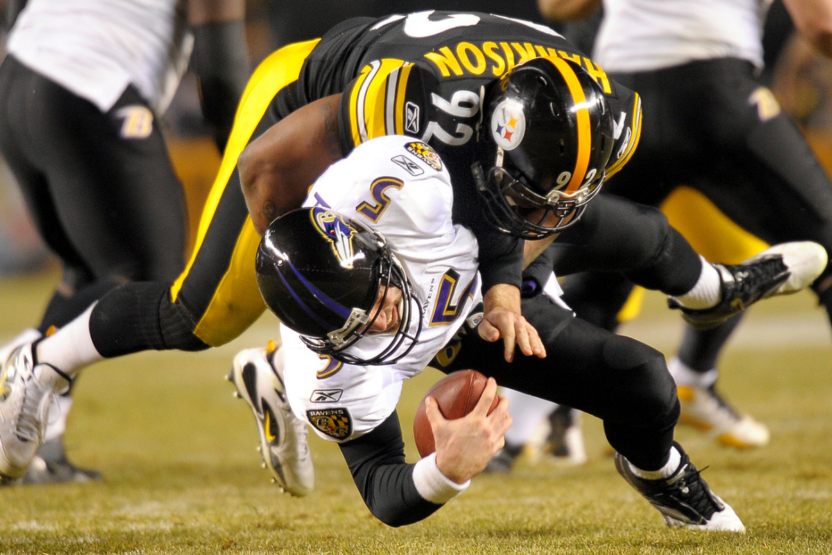 Harrison and Joe Flacco in a divisional-round playoff game, January 2011.