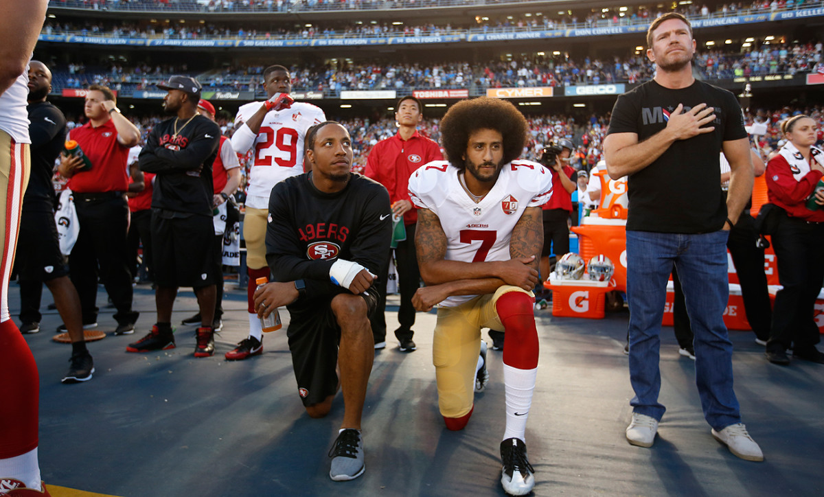 Colin Kaepernick was flanked by Eric Reid (left) and Nate Boyer during the national anthem before a Week 4 preseason game.