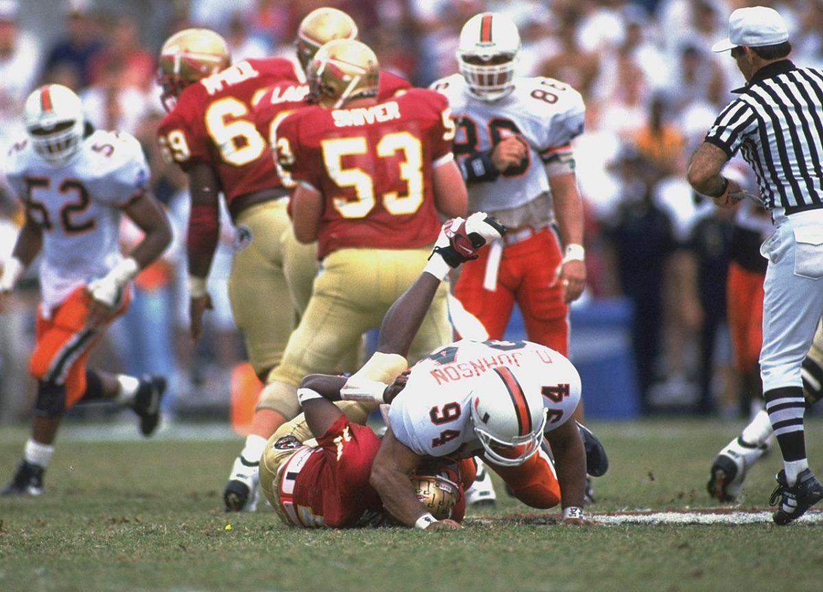 1993-Dwayne-The-Rock-Johnson-Miami-Charlie-Ward-Florida-State-05149888.jpg