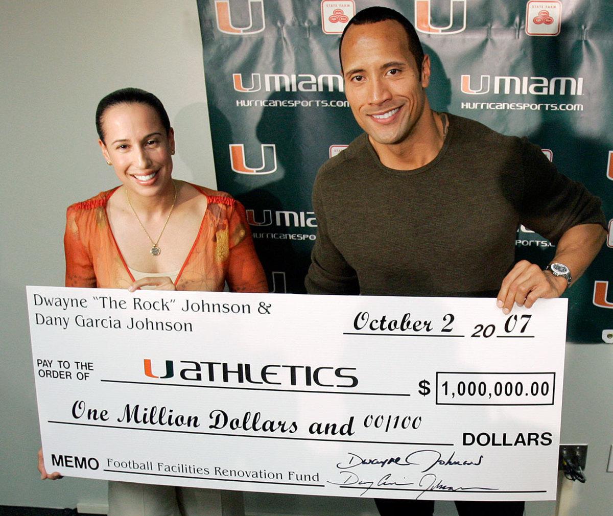 2007-Dwayne-The-Rock-Johnson-ex-wife-Dany-Garcia-Miami-donation.jpg