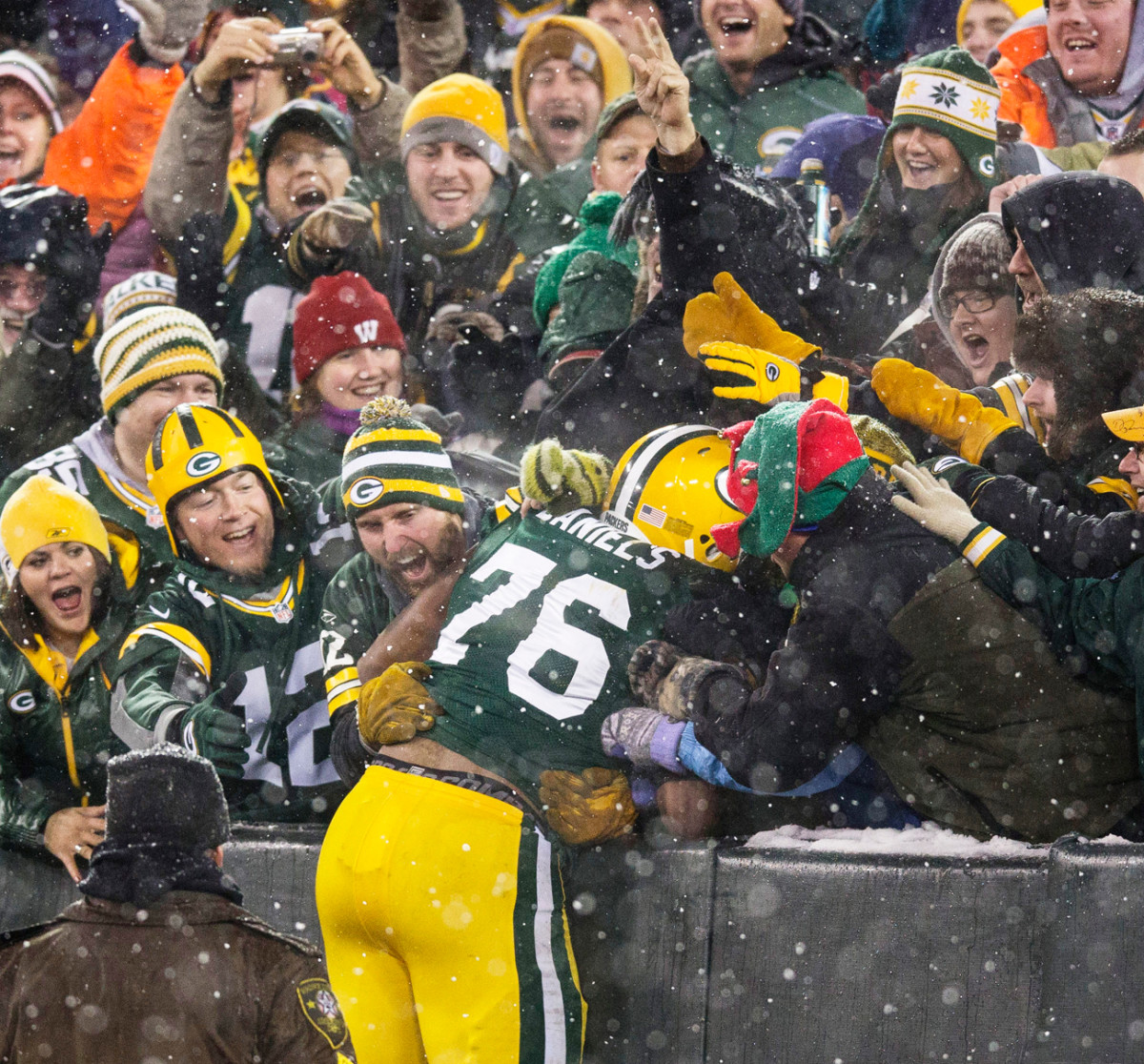 Mike Daniels shows less-than-perfect form on his firm Lambeau Leap.