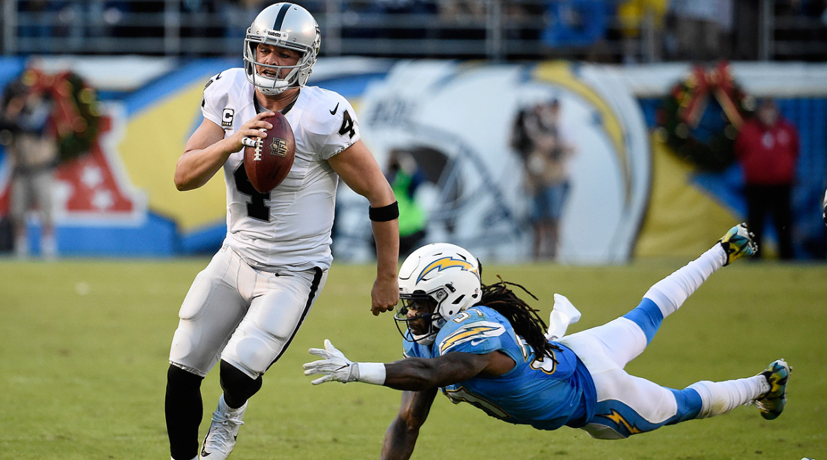 Derek Carr helped clinch the franchise's first playoff berth since 2002 with a 19-16 win over San Diego on Sunday.