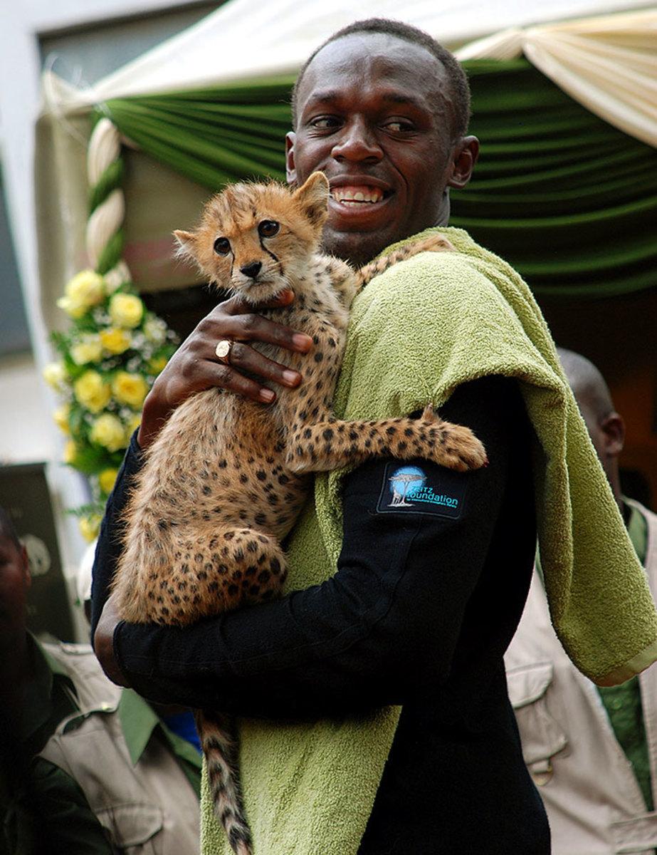 2009-1102-Usain-Bolt-cheetah-cub.jpg