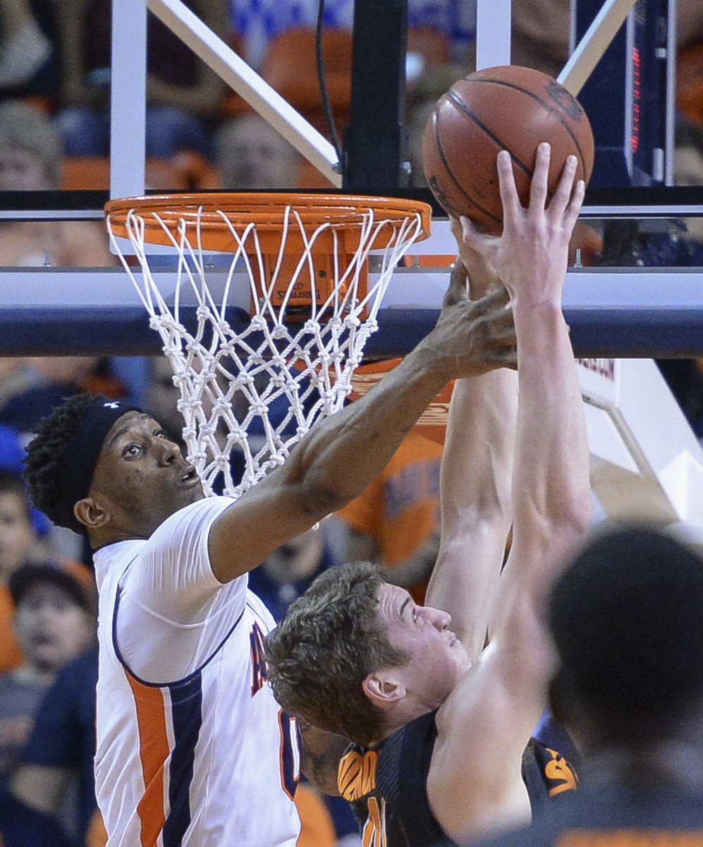 Auburn forward Horace Spencer, left, fouls Oklahoma State forward Mitchell Solomon during the second half of an NCAA college basketball game Saturday, Jan. 30, 2016, in Auburn, Ala. (Julie Bennett/AL.com via AP) MAGAZINES OUT; MANDATORY CREDIT