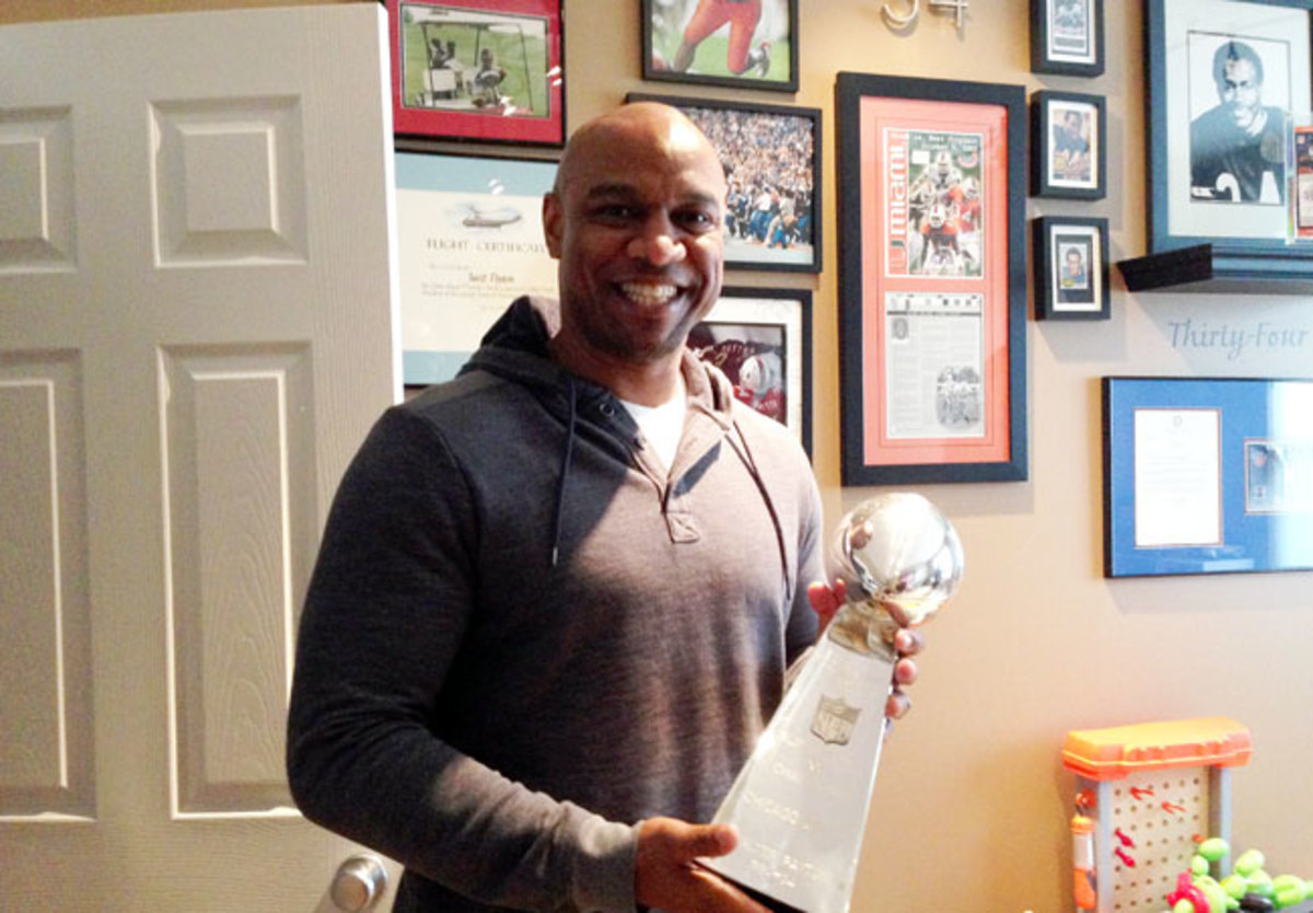 Jarrett Payton in his office with memorabilia of his father.