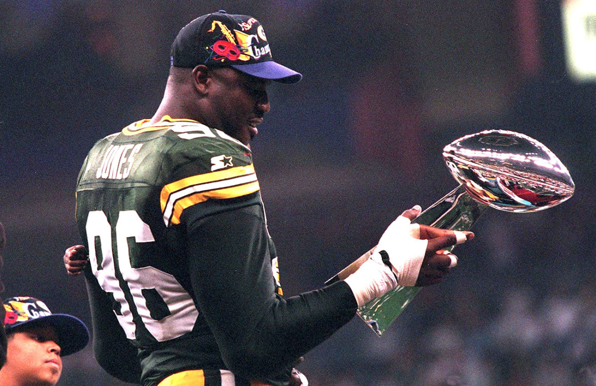 Sean Jones admires the Lombardi Trophy after Super Bowl XXXI.
