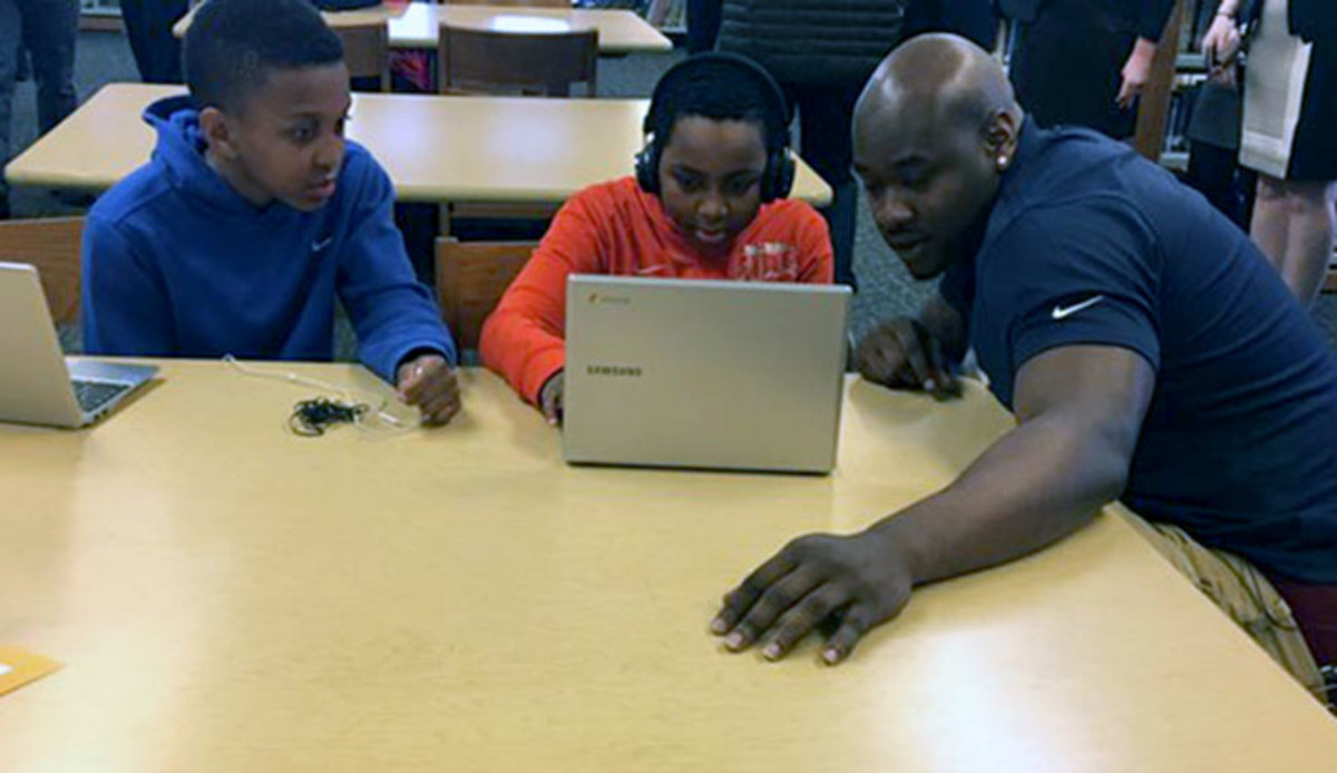 In happier times (earlier on Thursday), Laremy Tunsil visited with Chicago schoolchildren.