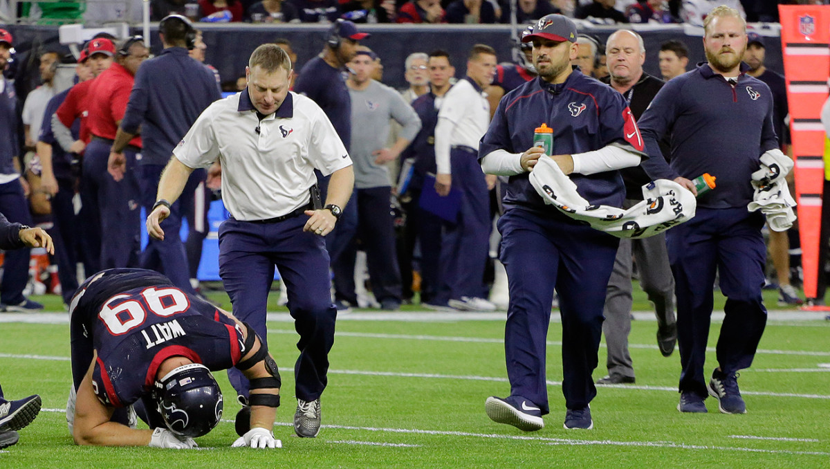 J.J. Watt went down during the Texans' wild-card game against the Chiefs and was escorted off the field by medical staff.