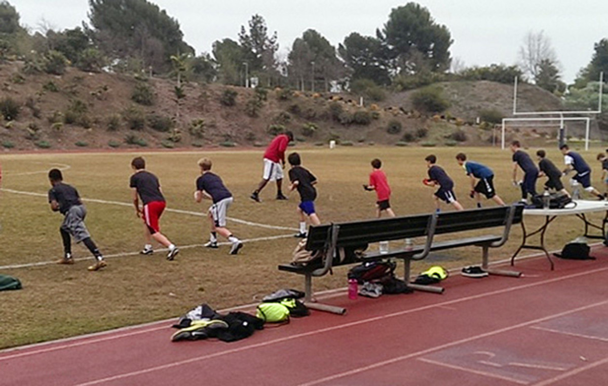 Mike Williams (background, in red) leading drills at Brentwood Junior High.