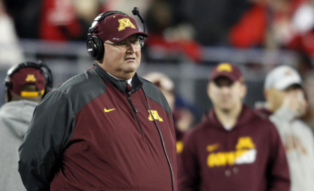 FILE - In this Nov. 7, 2015, file photo, Minnesota interim coach Tracy Claeys watches during an NCAA college football game against Ohio State in Columbus, Ohio. Claeys was named Minnesota's head coach on Nov. 11, 2015, succeeding his good friend Jerry Kil